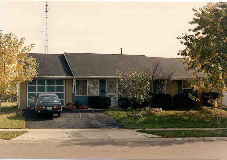 The New Carlisle digs, ca 1984 (that's me crouched down by the garage door.